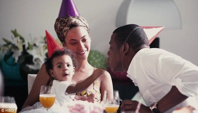 Blue Ivy, Beyoncé and Jay Z wear party hats as they celebrate a birthday in 'Lemonade.'