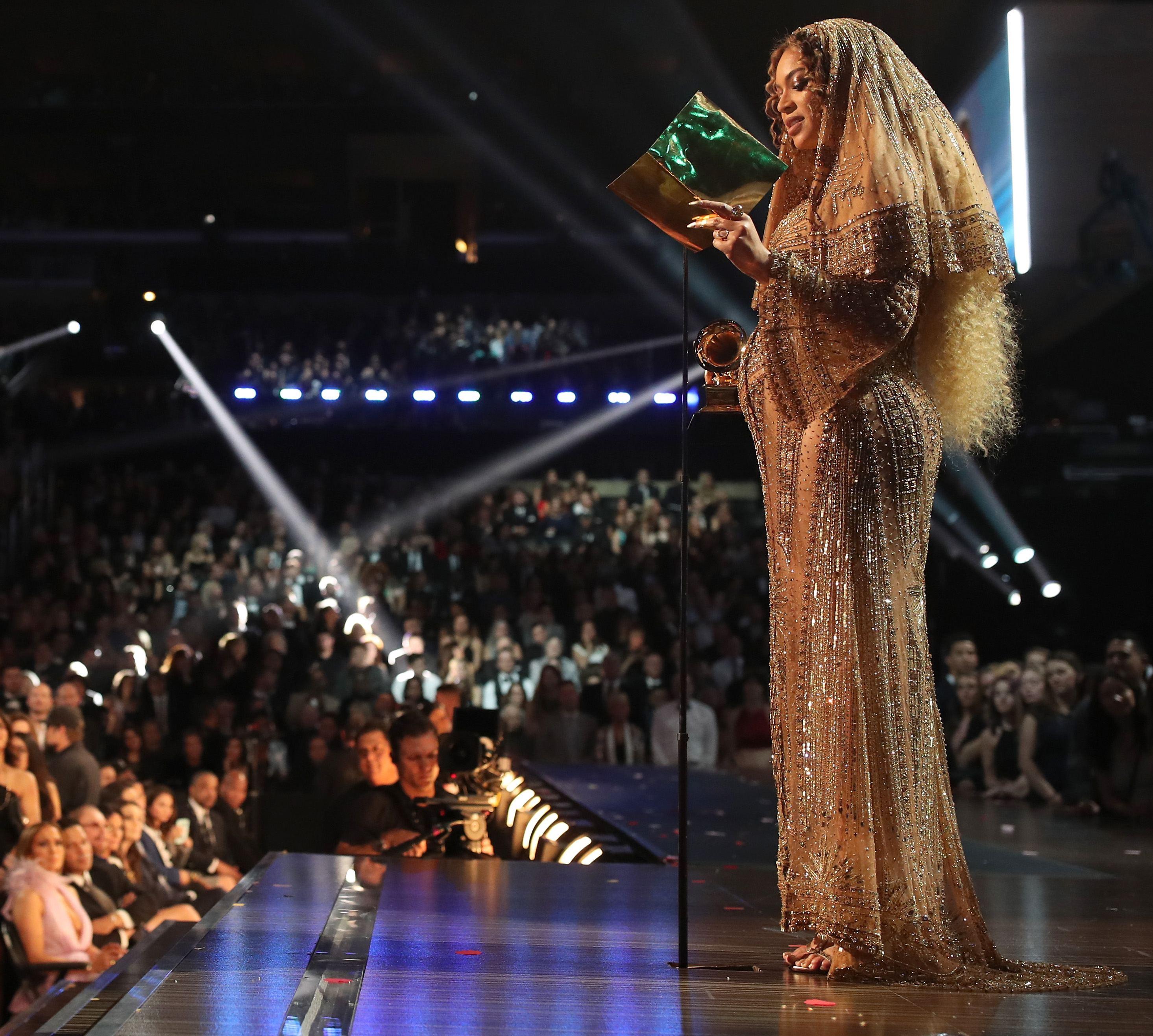 Beyoncé reads her acceptance speech during the 2017 Grammy Awards.