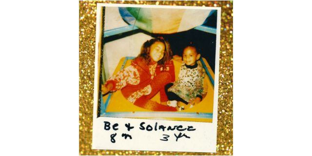 A Polaroid photo set on a gold glittery backdrop shows an 8-year-old Beyonce and 3-year-old Solance Knowles sitting and smiling together.