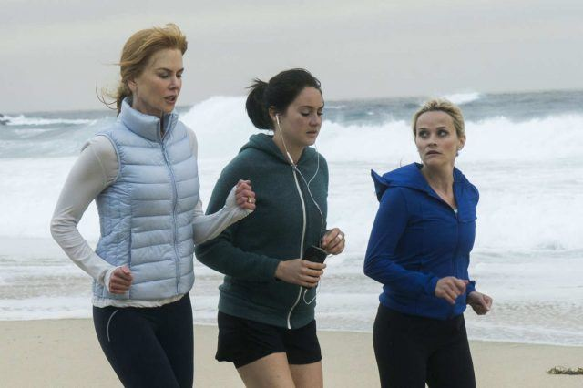 Celeste, Jane and Madeline jog on the beach on an overcast day in a scene from 'Big Little Lies.'