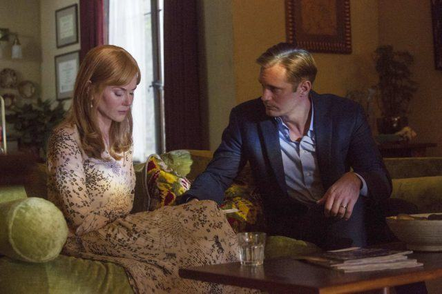 Celeste looks down and Perry reaches out to her as they sit on their therapist's couch in a scene from 'Big Little Lies.'