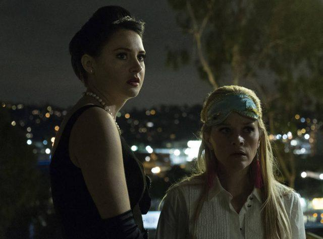 Jane (Shailene Woodley) and Madeline (Reese Witherspoon) look shocked during a tense moment at Trivia Night in a scene from 'Big Little Lies' seventh episode.