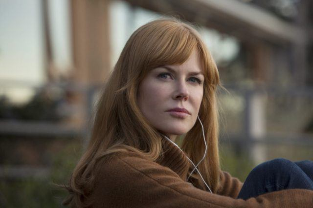 Celeste sits on her patio and listens to music on her headphones in a scene from 'Big Little Lies.'
