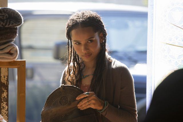 Bonnie (Zoe Kravitz) examines a purse in a scene from 'Big Little Lies.'