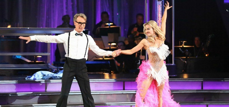 Bill Nye and Tyne Stecklein are holding hands while dancing on the show.
