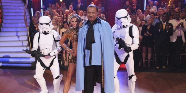 Billy Dee Williams poses with partner Emma Slater and two stormtroopers on 'Dancing With the Stars.'