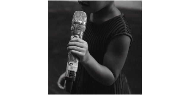Blue Ivy holds a microphone with Dora the Explorer stickers decorating the handle in a black and white photo from Beyonce's Instagram account.