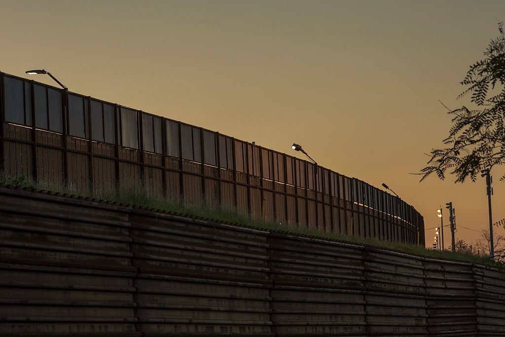 Multiple layers of steel walls, fences, razor wire and other barricades are seen on the US- Mexico border