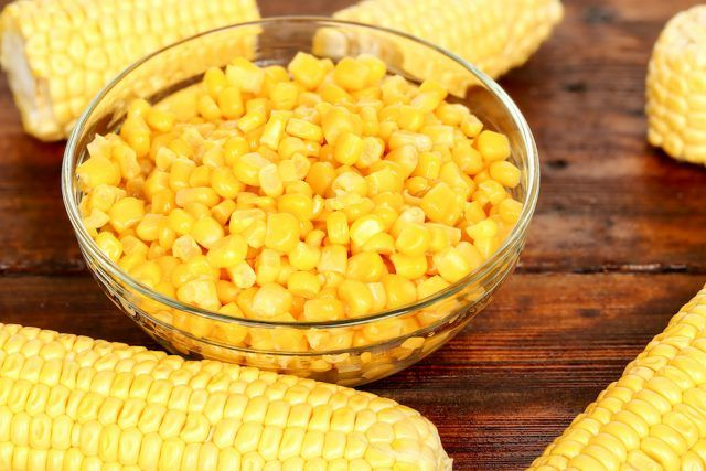 bowl of sweet corn on wooden table