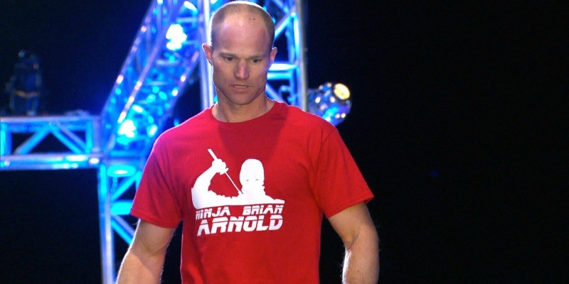 Brian Arnold competing in his red ninja warrior t shirt