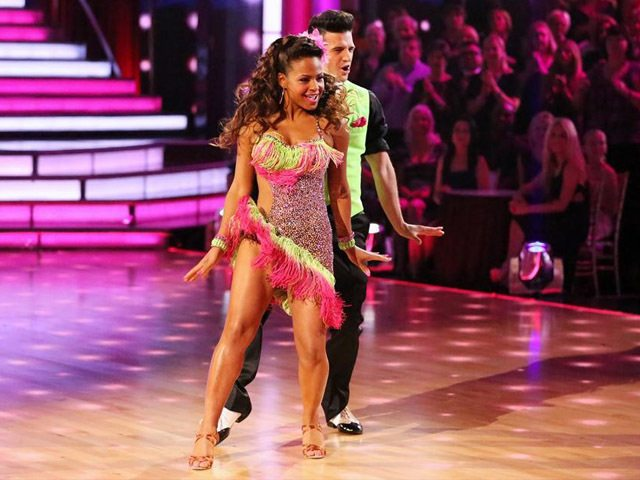 Christina Milian and Mark Ballas wear neon pink and green costumes on 'Dancing With the Stars.'