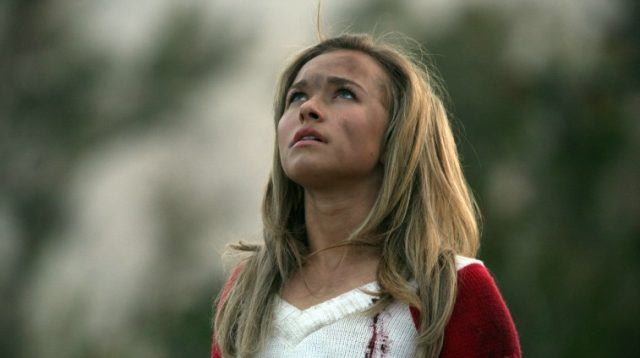 Hayden Panettiere as cheerleader Claire Bennet looks up into the sky with dirt on her face on Heroes