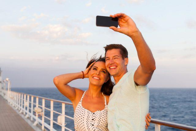 Couple taking photo of themselves on cruise