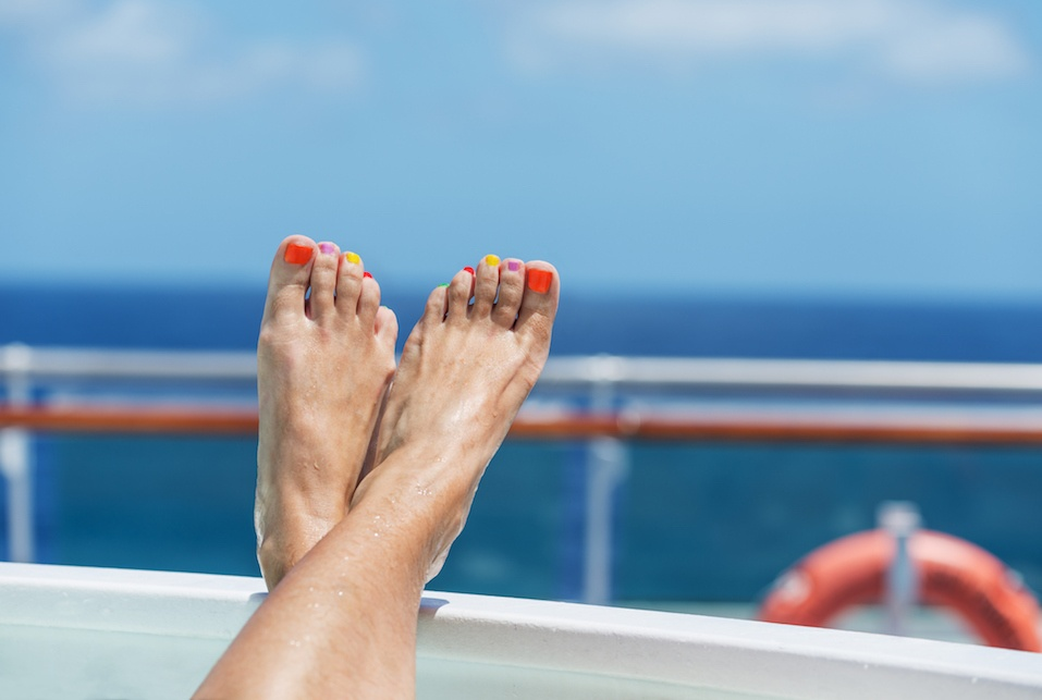 feet propped up on cruise ship deck