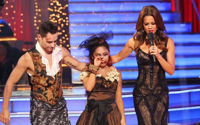 Snooki cries as she's led off the 'Dancing with the Stars' stage by partner Sasha Farber and co-host Brooke Burke.