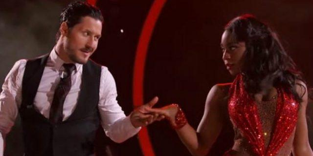 Val reaches for Normani's hand as they are dancing on the show.