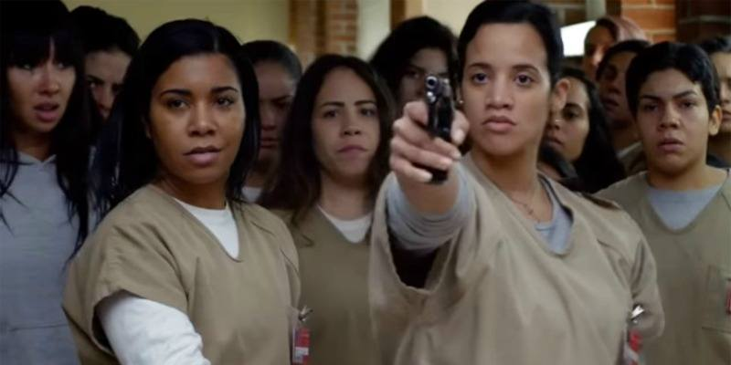 Daya holds up a gun next to other inmates on 'Orange is the New Black.'