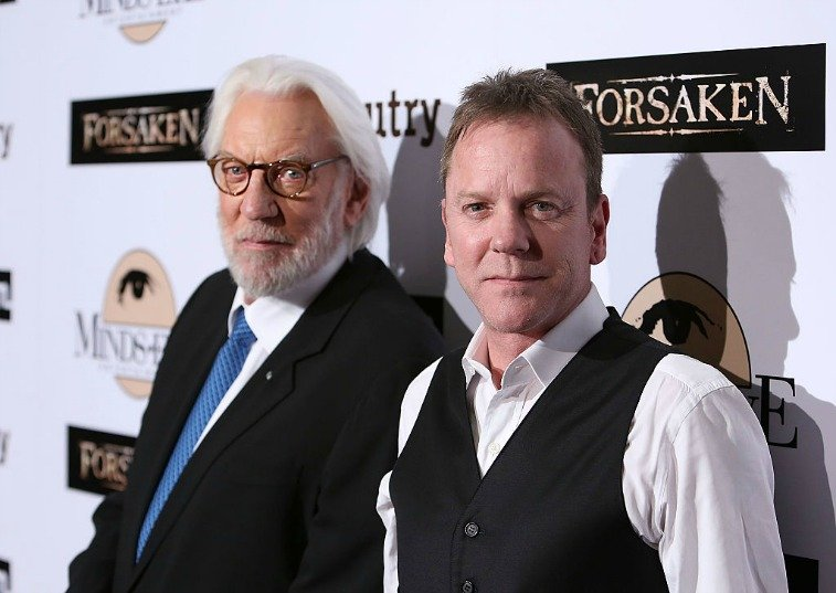 Donald Sutherland and Kiefer Sutherland in front of a white backdrop