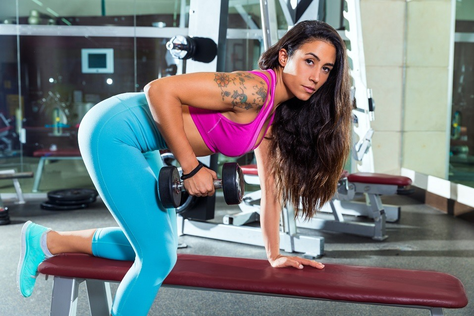 Girl workingout in gym