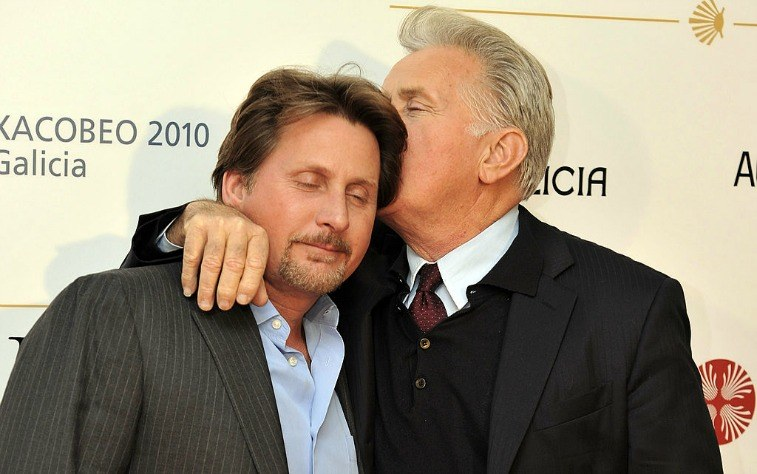 Martin Sheen kissing son Emilio Estevez on the head