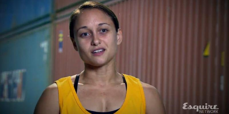Erica Cook is talking to the camera and wearing a yellow tank top on Team Ninja Warrior.