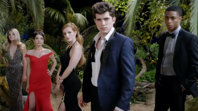 The cast of Famous in Love pose in front of trees in evening wear