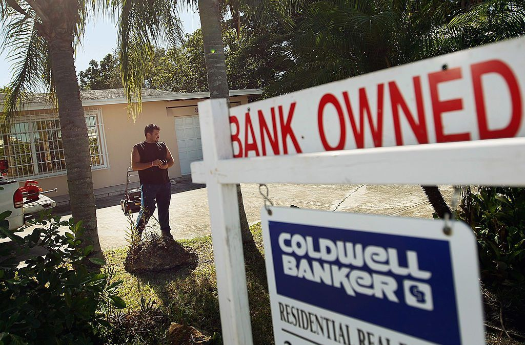 "foreclosed home with sign that says ""bank owned"""