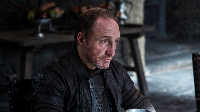 Roose Bolton, sitting at a table, in a scene from 'Game of Thrones.'