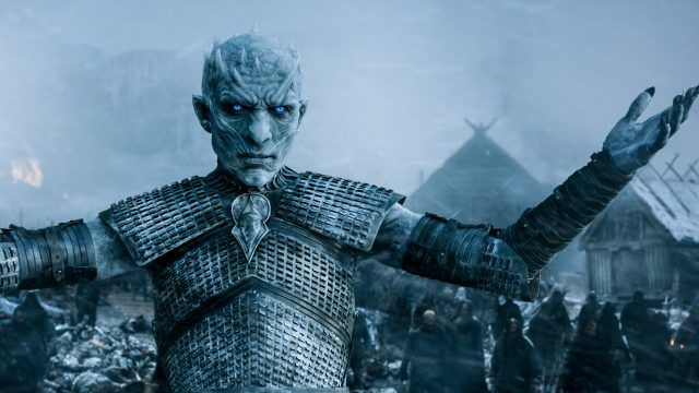 A White Walker stands with his arms raised in a scene from 'Game of Thrones.'