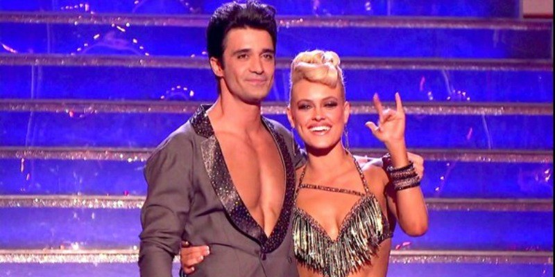 Gilles Marini and Peta Murgatroyd have their arms around each other and she had a hand up in the air.