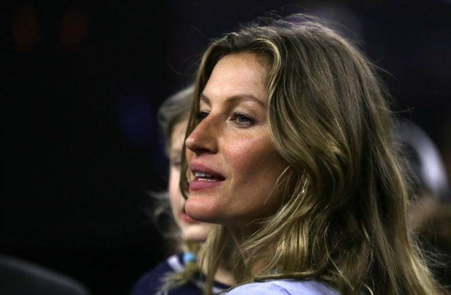 Gisele Bündchen while staring to the side.