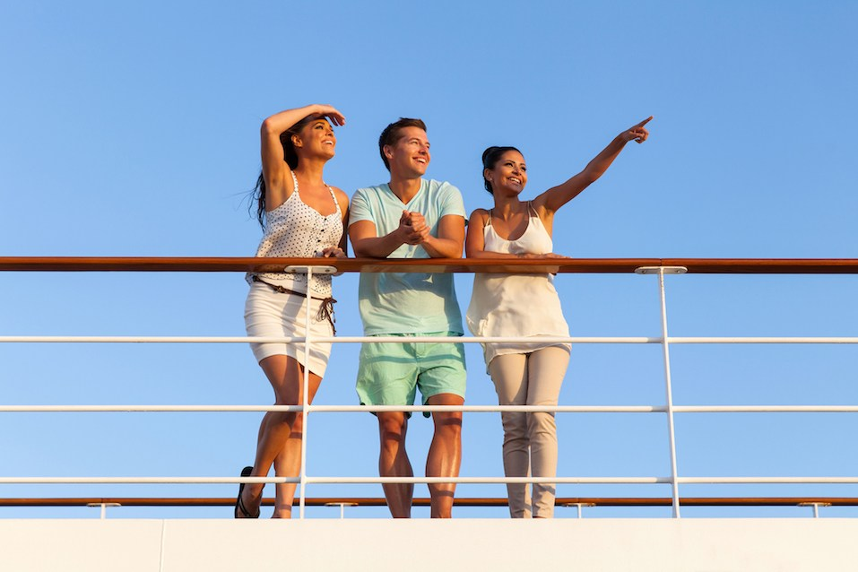 Friends enjoying sunset on cruise