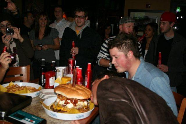 man about to eat massive burger