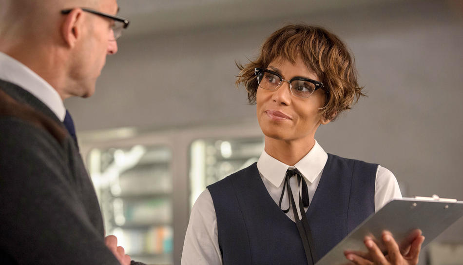 Halle Berry wearing glasses, holding a tablet
