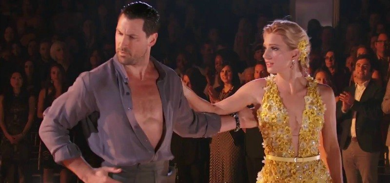 Heather Morris looks to Maksim Chmerkovskiy looks away while dancing on the show.