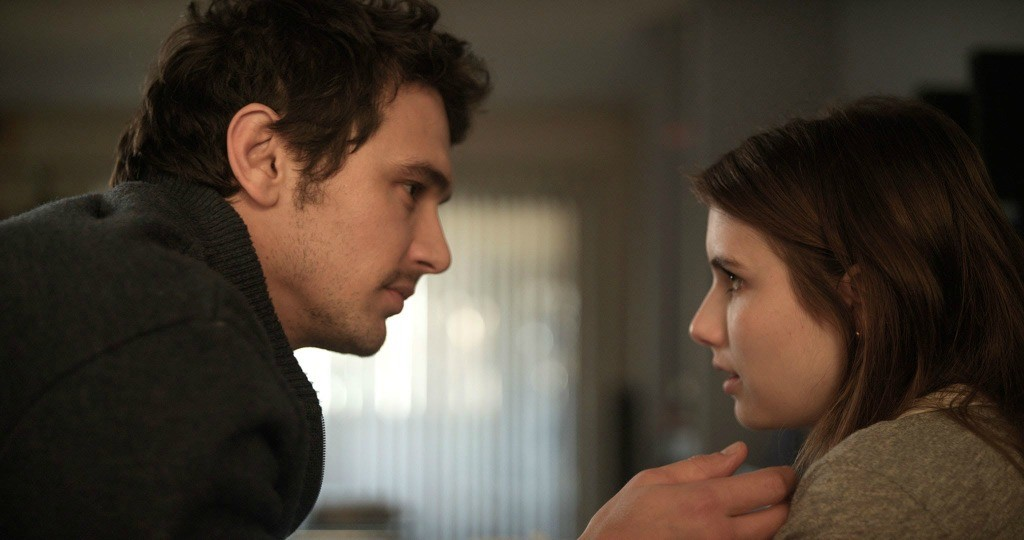 James Franco as Mr. B and Emma Roberts as April looking at each other in Palo Alto