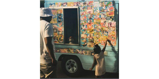 Jay Z stands back as Blue Ivy points out what she wants from an ice cream truck.