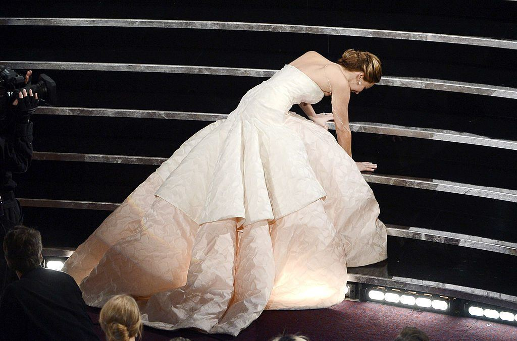 Actress Jennifer Lawrence falling down with climbing the stairs at the Oscars