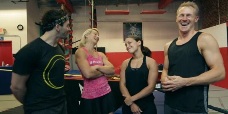Jessie Graff, Drew Dreschsel, Erica Cook, and Evan Dollard talk in front of a ninja warrior gym.