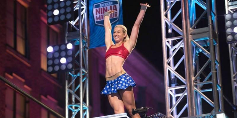 Jessie Graff has her hands in the air on Team Ninja Warrior.