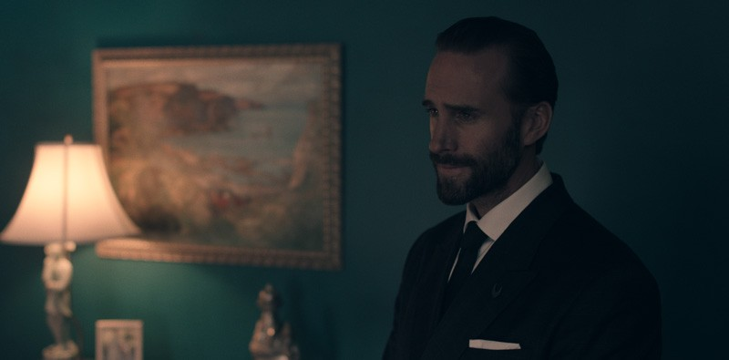 The Commander is in a suit and looking serious in The Handmaid's Tale.