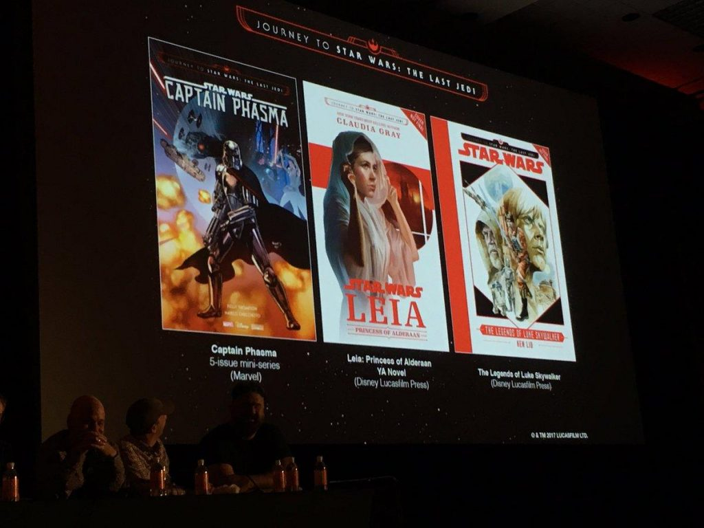 """Cover art for three """"Journey to The Last Jedi"""" publications, on-stage at a Del Rey Star Wars panel"""