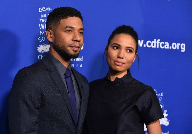 Siblins Jussie Smollett and Jurnee Smollett-Bell pose in front of a blue backdrop