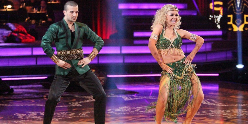 Katherine Jenkins and Mark Ballas stand side by side and have their hands on their hips while dancing.