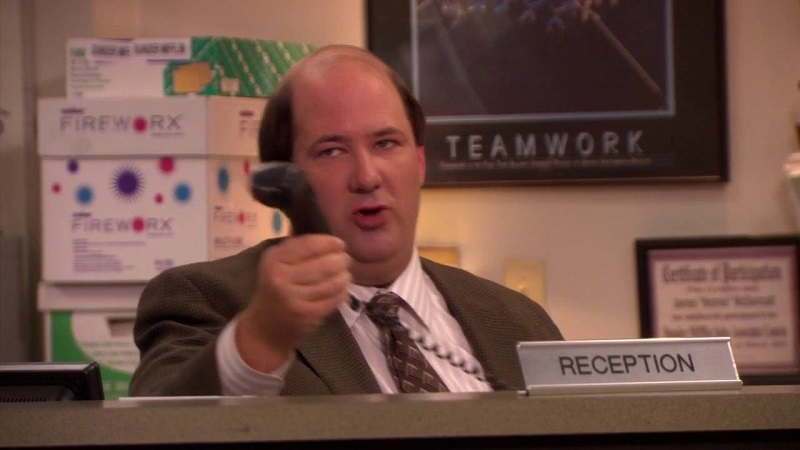 Kevin Malone of The Office, feeling confused about his job description, acts as receptionist.