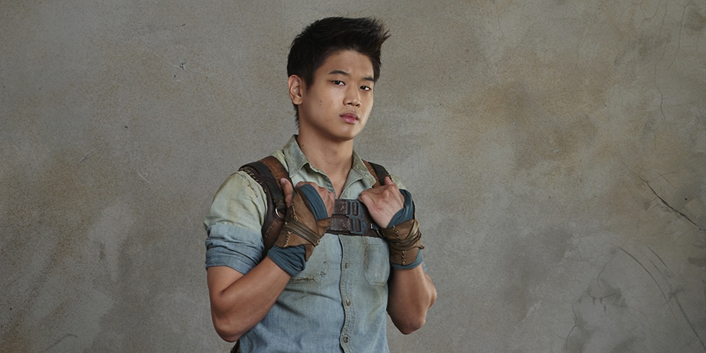 Ki Hong Lee with his hands on his shoulders, posing for a Maze Runner promo image