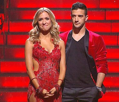 Kristin Cavallari wears a red fringe dress and Mark Ballas wears a matching red and black blazer on 'Dancing With the Stars.'