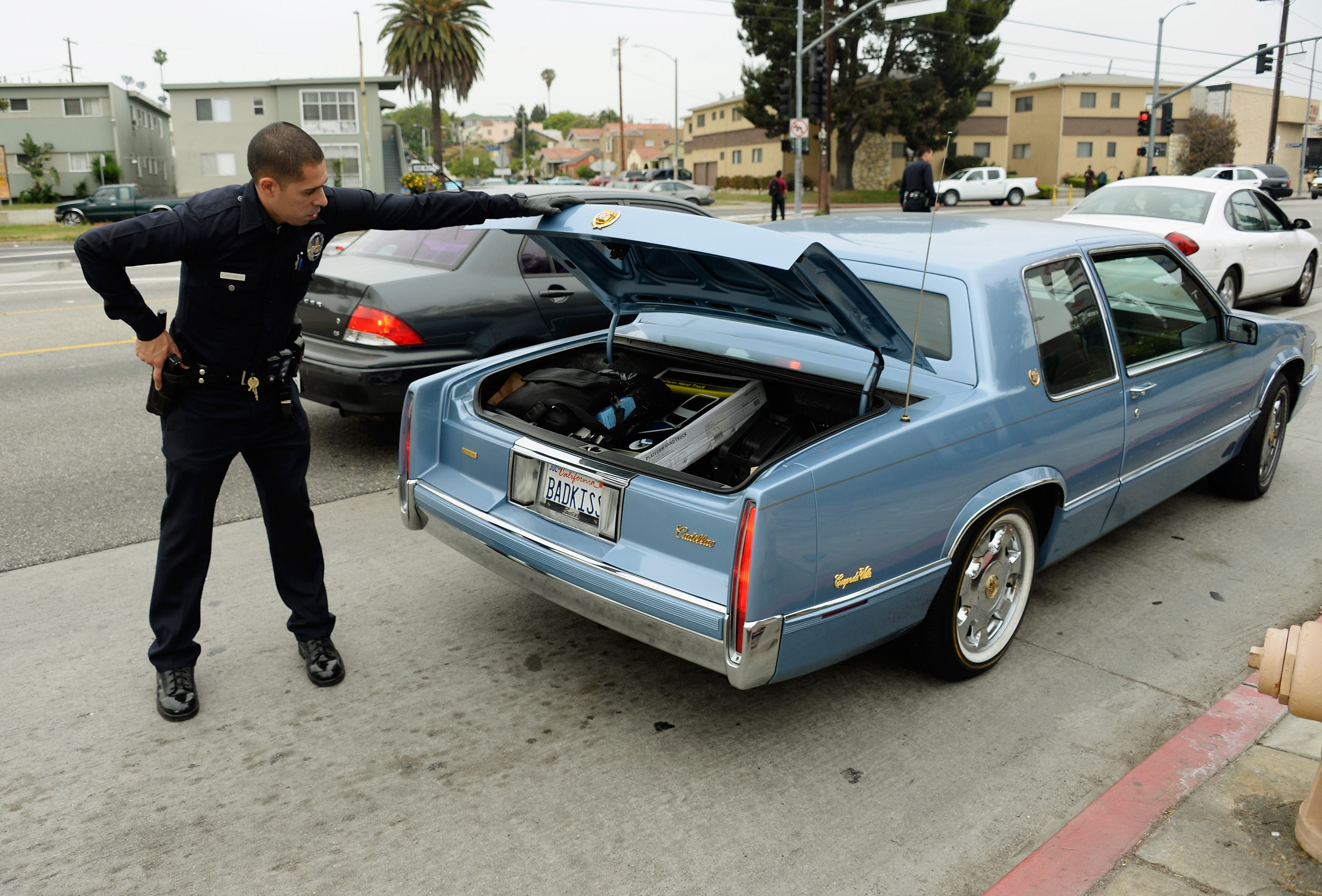 Los Angeles Police Department officers search cars