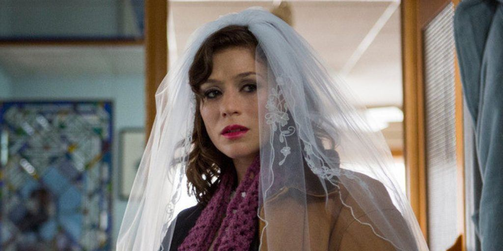 Yael Stone as Lorna Morello looking sad while wearing a wedding veil on Orange Is the New Black