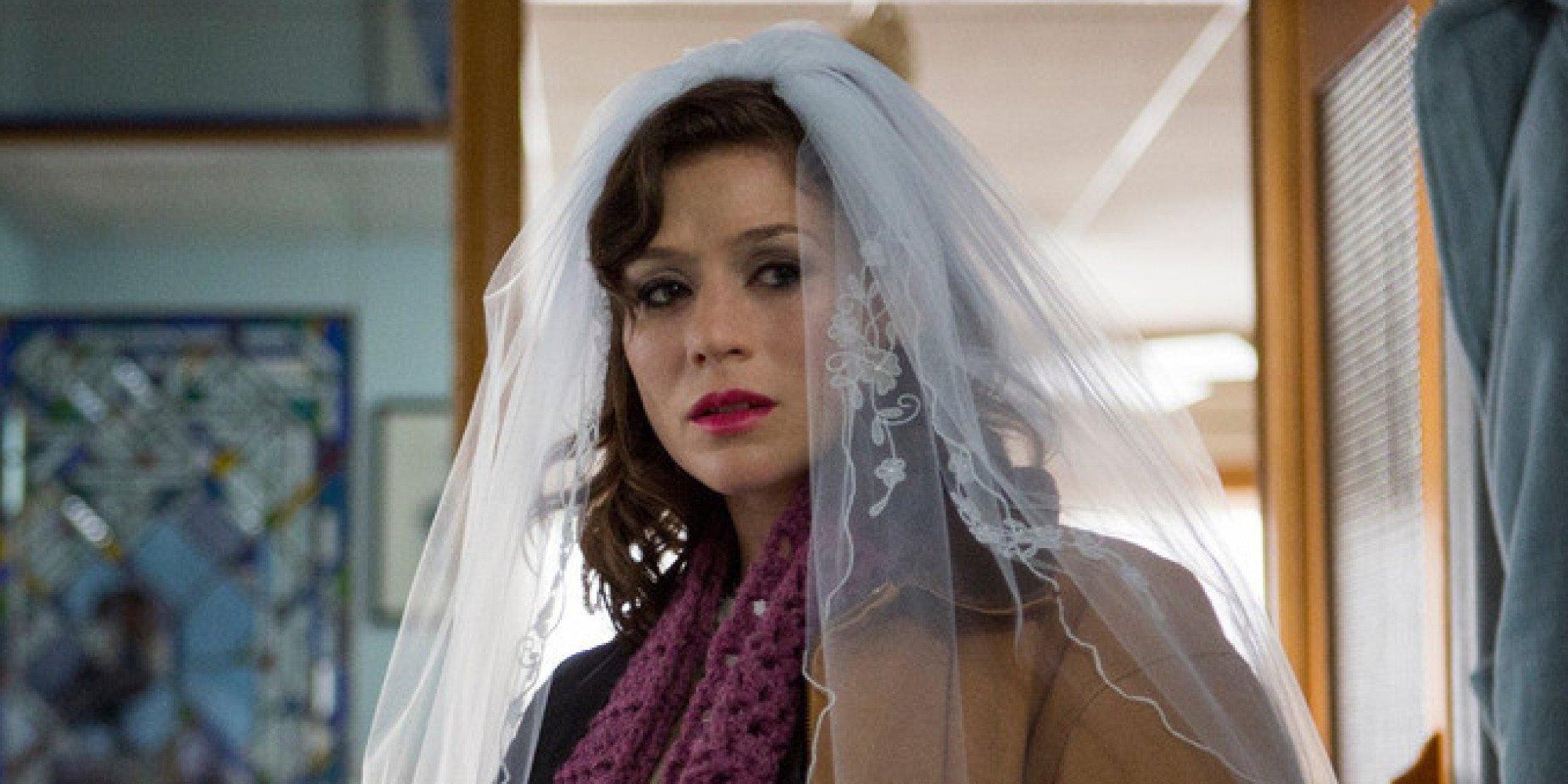 Yael Stone as Lorna Morello looking sad while wearing a wedding veil on Orange Is the New Black